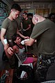 US Navy 090417-M-0633T-019 Armed Forces of the Philippines Chief Hospital Corpsman Jesus D. De Guia, right, and Navy Hospitalman Jin Lin, assigned to the 31st Marine Expeditionary Unit, extract a tooth during a medical civic ac.jpg