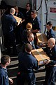US Navy 100105-N-2600H-042 Sailors pass stores received from USNS Kanawha (T-AO 196) during a replenishment at sea.jpg