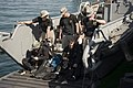 US Navy 100118-N-1134L-274 Members of the Army's 544th Engineer Dive Team prepare to conduct underwater pier inspections of the port in Haiti.jpg