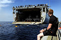 US Navy 100321-N-7948C-032 Engineman 3rd Class Bryce Tucker watches from a rigid-hull inflatable boat as Sailors participate in a swim call.jpg