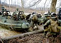 US Navy 100328-N-4153W-088 Members of Riverine Squadron (RIVRON) 1 load into a riverine patrol boat during a simulated fire fight at Fort Knox, Ky.jpg