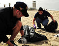 US Navy 100424-N-0808V-022 Logistics Specialist 1st Class Marcos Maldonado and Logistics Specialist 1st Class Lillian Morales olunteer during the Creek to Bay Clean-up to collect trash along Silver Strand State Beach.jpg