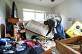 US Navy 100510-N-5319A-003 Machinist Mate 2nd Class Benson Kungu inventories what is left of his home after severe flooding hit Naval Support Activity Mid-South.jpg