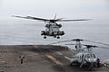 US Navy 100601-M-5373N-013 A U.S. Marine Corps CH-53E Super Stallion helicopter comes lands behind a CH-46 Sea Knight helicopter aboard the amphibious assault ship USS Bonhomme Richard (LHD 6) during Operation Dawn Blitz.jpg