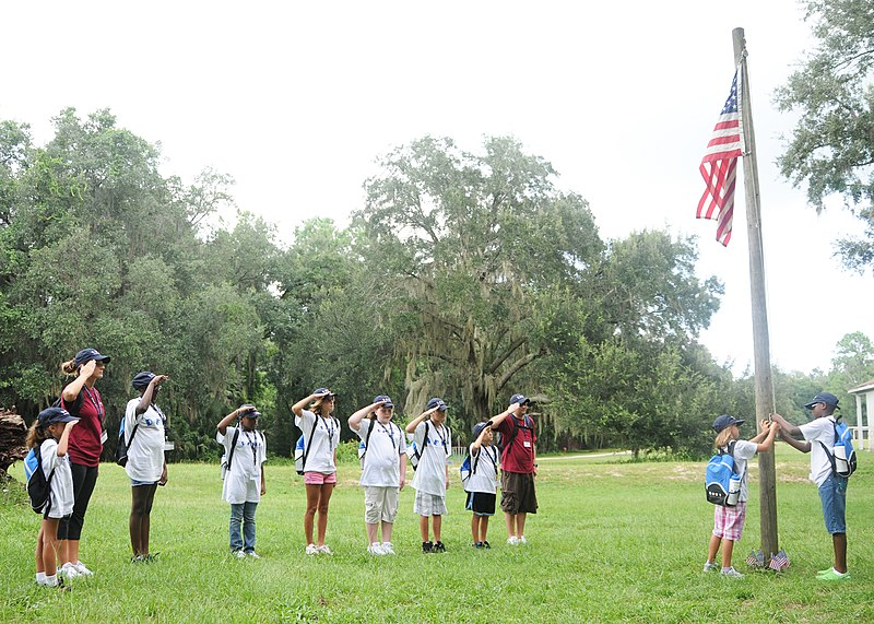 File:US Navy 100809-N-3013W-003 A team of Drug Education for Youth (DEFY) summer camp attendees from Naval Air Station Jacksonville and their mentors salute the national ensign during colors at Camp McConnell in Micanopy, Fla.jpg