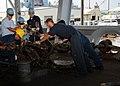 US Navy 101105-N-5620H-114 Seaman Recruit Tyler S. Wilkins assists civilian mariners moor the submarine tender USS Frank Cable (AS 40).jpg