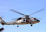 US Navy 101211-N-0046R-071 Santa Claus flies in an SH-60F Sea Hawk helicopter assigned to Commander, Helicopter Sea Combat Wing Pacific.jpg