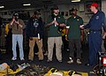 US Navy 110214-N-2908M-074 Super Bowl XLV champions, the Green Bay Packers, are briefed on fire fighting equipment by Damage Controlman 2nd Class S.jpg