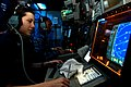 US Navy 110621-N-GL340-038 Cryptologic Technician (Technical) 3rd Shayna Ramsey monitors a radar in the combat direction center aboard USS Ronald R.jpg