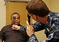 US Navy 110707-N-BC134-039 Cmdr. Richard Zeber performs an eye exam at the Kosrae hospital during Pacific Partnership 2011.jpg