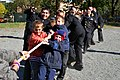 US Navy 111003-N-BS854-150 Sailors assigned to the guided-missile destroyer USS Fitzgerald (DDG 62) pull a tug-of-war rope with children from Parus.jpg