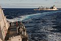 US Navy 111130-N-XQ375-310 he guided-missile destroyer USS Mitscher (DDG 57) breaks away from the guided-missile cruiser USS Anzio (CG 68) and the.jpg