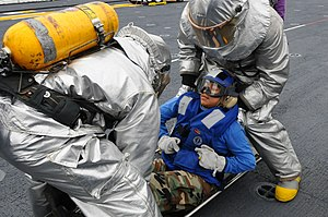 US Navy 111212-N-SB587-008 Sailors put Aviation Boatswain's Mate (Handling) Airman Indra Ramirez onto a stretcher during a training exercise aboard.jpg