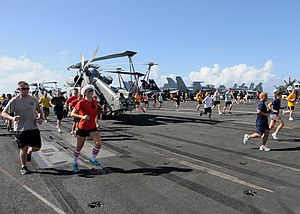 US Navy 111225-N-NB694-049 Sailors participate in a 5k reindeer fun run on the flight deck of the Nimitz-class aircraft carrier USS Abraham Lincoln.jpg