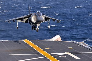 US Navy 120112-N-UM734-268 An AV-8B Harrier performs a vertical landing on the flight deck of the amphibious assault ship USS Kearsarge (LHD 3).jpg