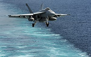 US Navy 120216-N-VO377-442 An F-A-18E Super Hornet assigned to the Kestrels of Strike Fighter Squadron (VFA) 137 approaches the flight deck of the.jpg