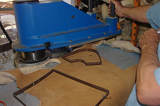 Ugg boots - Cutting boot pieces from a sheepskin using a cutting press
