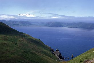 Unalaska Bay - Broad Bay and the Makushin Volcano partly hidden by low clouds and the Makushin valley.