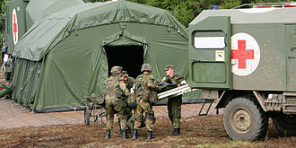 Army Medical Service (Germany) - Personnel, facilities and ambulance of the Army Medical Service, which all display the red cross as a protective sign, during a military exercise, 2010