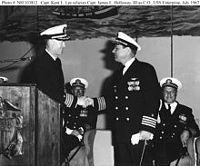 Capt. Kent Lee (left standing) taking command of the USS Enterprise