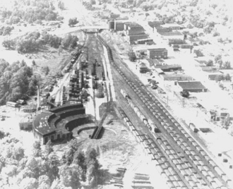 Virginian Railway - An aerial shot of Victoria in 1954, looking west. It shows the turntable and roundhouse in the lower left, and the passenger station and Norfolk division offices to the right of the tracks
