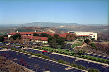 Over view of the library and parking lot nestled in the hills