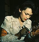 WWII Woman aircraft inspector checking electrical assemblies, Vega Aircraft Corporation, Burbank, California in June 1942 (cropped).jpg