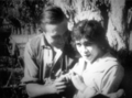 Wallace Reed and Nell Franzen in Love and the Law, 1913.png