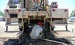 Well drillers clean equipment 150808-F-LP903-0503.jpg