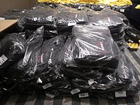Wikimania 2015-Wednesday-Backpacks at end of day.jpg