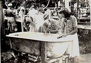 Santo Tomas Internment Camp - Women internees at Santo Tomas wash their hair at a communal bath.