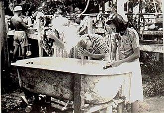 Santo Tomas Internment Camp - Women internees at Santo Tomas wash their hair at a communal bath.