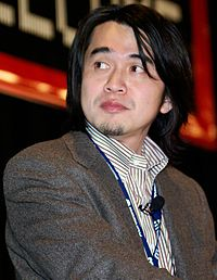 A picture of Yoshiaki Koizumi, the game's director and designer.