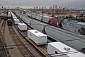(Hurricane Katrina) New Orleans, LA, 1-22-06 -- A load of 184 Trailers arrives in the New Orleans train yard. FEMA is delivering about 500 Travel Trailers per day to help house Hurr - DPLA - ac98c3e17cc25263af2f99188f2643c2.jpg