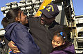 011223-N-9818S-004 Sailor Returns Home to Family.jpg