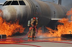 Airmen from the 312th Training Squadron extinguish a fire on a training module to demonstrate an aircraft incident at Goodfellow AFB.