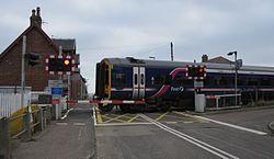 158714 crossing Brora Level Crossing (14982596759).jpg