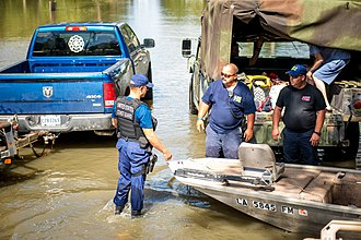 2016 Louisiana floods - The US Coast Guard coordinating rescue operations with the St. Amant Fire Department in the Baton Rouge area.