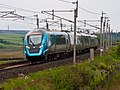 397011 at Scout Green with an Edinburgh to Manchester Airport service.jpg
