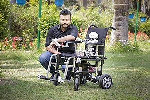 Mind-controlled wheelchair - Diwakar Vaish, the inventor of the wheelchair at the press launch, with his brainchild, Manav, on the wheelchair.