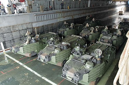 Amphibious vehicles inside a US LSD. AAVs preparing to debark USS Gunston Hall (LSD 44).jpg