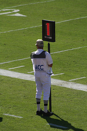 Down (gridiron football) - A down marker showing first down along the sideline of a collegiate game