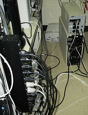 Power distribution unit - A 10-outlet rack-mount PDU without built-in surge protection, connected to a UPS (bottom unit on right)