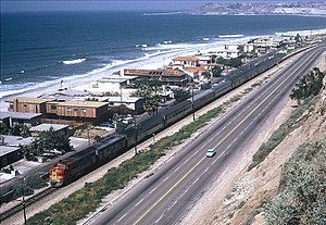Surf Line - The southbound San Diegan passes through Capistrano Beach, California on the Surf Line in April 1973.