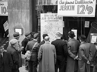People in London look at a map illustrating how the RAF is striking back at Germany during 1940 A British airman is amongst a group of civilians crowded around the window of a shop in Holborn, London, to look at a map illustrating how the RAF is striking back at Germany during 1940. D1254.jpg