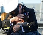 A Chief Petty Officer from HMS Richmond, is reunited with his family after a deployment at sea. MOD 45160230.jpg
