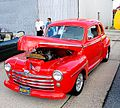 A Ford 2 door coupe. Unknown year. I loved the color of red on the car.jpg