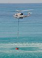 A Griffin helicopter from 84 Squadron, RAF Akrotiri lifts off with a 'Rainmaker' water bucket MOD 45147997.jpg