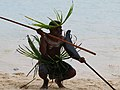 A Santa Catalina spear fighter squats on the sand and prepares to fight. (10663280233).jpg