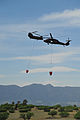 A U.S. Army CH-47 Chinook helicopter, left, assigned to the 4th Combat Aviation Brigade and a UH-60 Black Hawk helicopter assigned to the Colorado Army National Guard provide firefighting assistance for 130612-Z-WF656-007.jpg